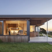 The home's softening larch cladding is echoed on