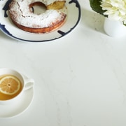 Dekton® and Silestone® by Cosentino in Neale Whitaker's bagel, baked goods, breakfast, ciambella, cuisine, dessert, dish, doughnut, food, ingredient, produce, saucer, white, gray