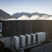 The contemporary home matches the rugged alpine environment black, gray