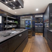 Matt black surfaces are teemed with shiny appliances black, gray