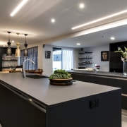 The finishes in this kitchen complement the fire gray, black