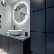 The wall-to-wall ledge and vanity top were specified bathroom, bathroom accessory, bathroom cabinet, interior design, public toilet, room, sink, black, gray