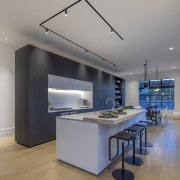 This is what an award-winning kitchen looks like. architecture, building, cabinetry, ceiling, countertop, design, floor, flooring, furniture, glass, hardwood, home, house, interior design, kitchen, laminate flooring, light fixture, lighting, living room, loft, material property, property, real estate, room, table, wood, wood flooring, gray