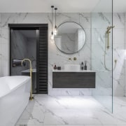 A large shower zone and freestanding bath make