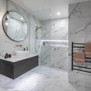 The main bathroom has a spa-like ambience with
