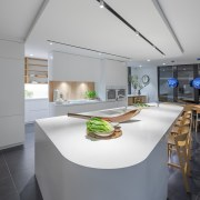A slender bulkhead helps define the kitchen and,