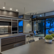 The strong interiors in this home, kitchen included, gray, black