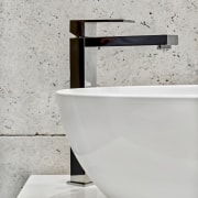 Square tapware contrasts the bathroom's many soft curves.