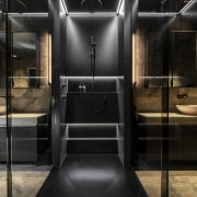 A central shower stall divides two sides of