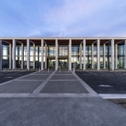 Tall colonnades in precast concrete create a dramatic