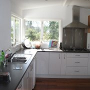 The home's existing kitchen. - Touching the scenery
