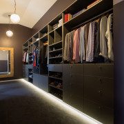 The walk-in wardrobe is a carefully planned arrangement closet, furniture, interior design, room, shelving, wall, wardrobe, black