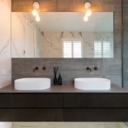 The owners wanted a luxury feel with an bathroom, bathroom accessory, ceramic, countertop, floor, home, interior design, plumbing fixture, room, sink, tap, tile, gray