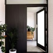 The entryway hints at the monochromatic palette that