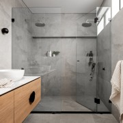 A generous double shower adds a sense of