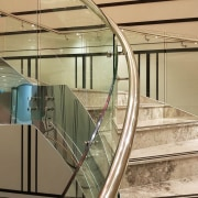 Doubletree Hilton 3 - architecture | glass | architecture, glass, handrail, line, metal, stairs, orange, brown