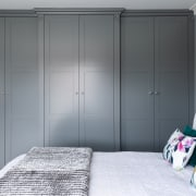The Mid grey Shaker style wardrobes were custom