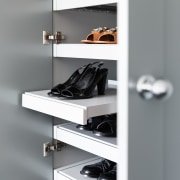 Pullout shoe storage operates smoothly on Blum fittings.