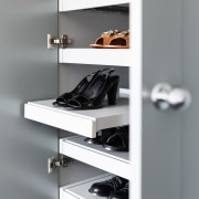 Pull out shoe drawers with discrete scallop handles