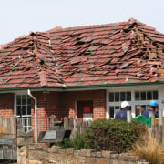 Earthquake 1 - cottage | facade | home cottage, facade, home, house, hut, outdoor structure, property, real estate, roof, brown