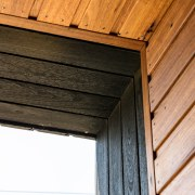 Deep Charred Black Timber cladding helps to define