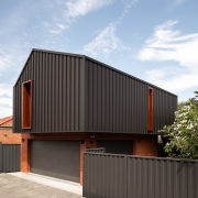 The brickwork on the garage/master suite extension echoes