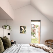The master suite's steep gabled roofline translates into