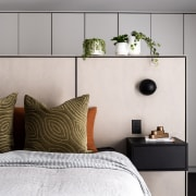 The tall bedhead helps separate the bedroom area