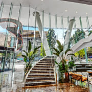 Emporium Hotel 3 - architecture | building | architecture, building, facade, house, interior design, lobby, mixed-use, plant, property, real estate, room, tree, gray