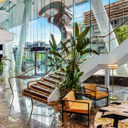 Emporium Hotel 4 - architecture | building | architecture, building, condominium, floor, home, hotel, house, houseplant, interior design, living room, lobby, plant, property, real estate, resort, room, tree, gray