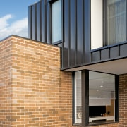 Existing bricks running one way, standing seam metal apartment, architecture, blue, brick, brickwork, building, daylighting, daytime, facade, glass, home, house, line, material property, property, real estate, residential area, siding, sky, wall, window