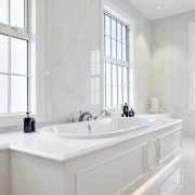 ​​​​​​​All the elements that make up this ensuite architecture, bathroom, bathroom accessory, bathtub, floor, flooring, furniture, plumbing fixture, sink, tap, tile, white, ingrid geldof design