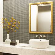 This first floor powder room combines understated high-end