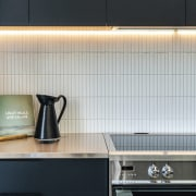 The user-friendly kitchen includes a durable stainless steel
