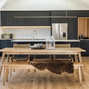 The living/family space's white and wood finishes and