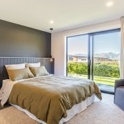 A character vertical weatherboard headboard features in the