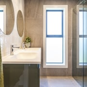 Light-filled, beautifully tiled and roomy, the master ensuite