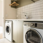 The walk-through laundry offers plenty of room to
