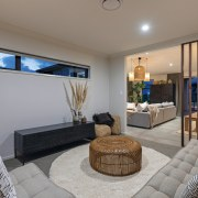 ​​​​​​​This Papamoa showhome's lounge or media room is gray