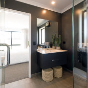 A Clearlite Cashmere wall-hung vanity in Charred Oak, architecture, bathroom, building, ceiling, door, floor, furniture, home, house, interior design, material property, plumbing fixture, property, real estate, room, tile, black, white