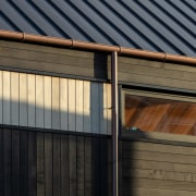 Timber cladding and glimpsed interior wood ceiling –