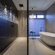 A large Victoria & Albert freestanding bath sits