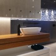 The bathroom vanity is as sculptural as it