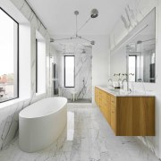 The grand bathroom hints at the rich architectural