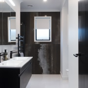 Character finishes continue into the master ensuite with
