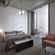 Restrained furniture is an apt choice for the apartment, architecture, bed, bed frame, bed sheet, bedding, bedroom, boutique hotel, building, ceiling, comfort, floor, furniture, house, interior design, loft, property, real estate, room, suite, table, gray, black