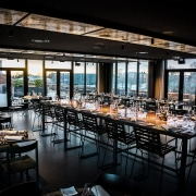 The hotel's roof terrace with restaurant is open architecture, bar, building, furniture, interior design, lunch, night, restaurant, room, sky, table, black