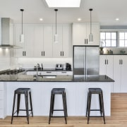 The aim of the renovation project was to cabinetry, countertop, cuisine classique, floor, interior design, kitchen, room, gray