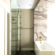 Gold-toned faucets add to the bathroom's sense of