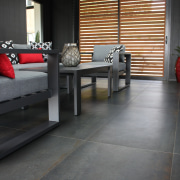 The outdoor room features Ferrocemento, Italian porcelain floor